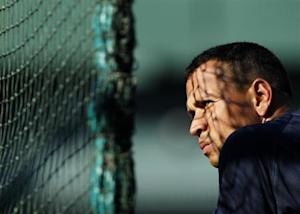 New York Yankees' Alex Rodriguez awaits turn in batting cage in Oakland