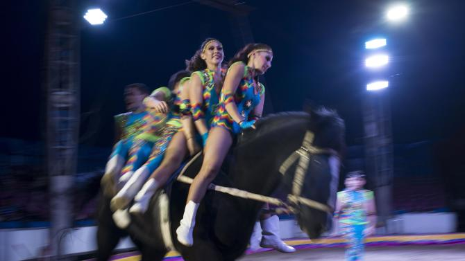 In this June 22, 2014, photo, performers ride a horse during one of their routines with the Fuentes Gasca Brothers Circus in Mexico City. Recent legislation in the city will ban animals from the circus once the law takes effect next year. The law promises steep fines for noncompliance. (AP Photo/Sean Havey)
