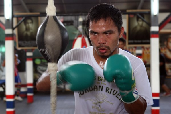 Manny Pacquiao works the speed ball at the Golingan Gymnasium in General Santos City. (Getty Images)