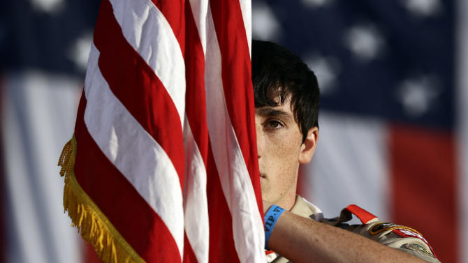 Boy Scout Nicholas Reade, 17, from Reynoldsburg, Ohio, stands during the trooping of the colors before Republican presidential candidate and former Massachusetts Gov. Mitt Romney and Republican vice presidential candidate, Rep. Paul Ryan, R-Wis., speak at a campaign event in Lancaster, Ohio, Friday, Oct. 12, 2012. (AP Photo/Charles Dharapak)