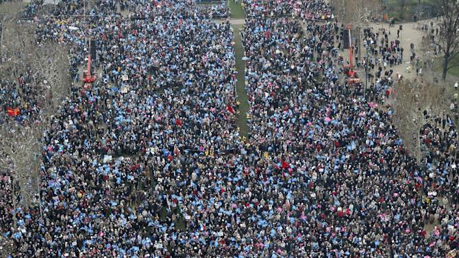 """In this over-head view made from the Eiffel Tower, some thousands of people gather on the """"Champs de Mars"""", in Paris, Sunday, Jan. 13, 2013.  Protesters are mobilizing against the French president's plan to legalize gay marriage, streaming into Paris by bus, car and train. (AP Photo/Michel Euler)"""