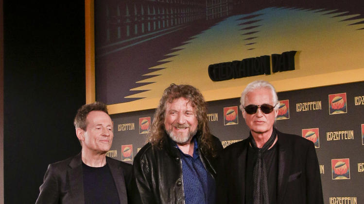 Bassist and keyboardist John Paul Jones, from left, frontman Robert Plant and guitarist Jimmy Page pose for photos at a media screening ahead of the worldwide theatrical release of Led Zeppelin's 2007 Celebration Day concert at the O2, on Friday, Sept. 21, 2012, in London. (Photo by Miles Willis/Invision/AP)