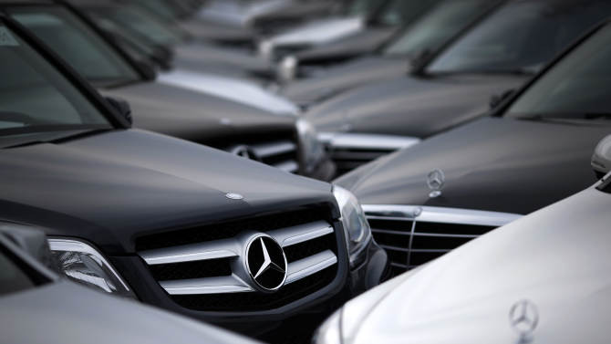 In this March 27, 2014 picture, rows of Mercedes-Benz cars and SUVs ...