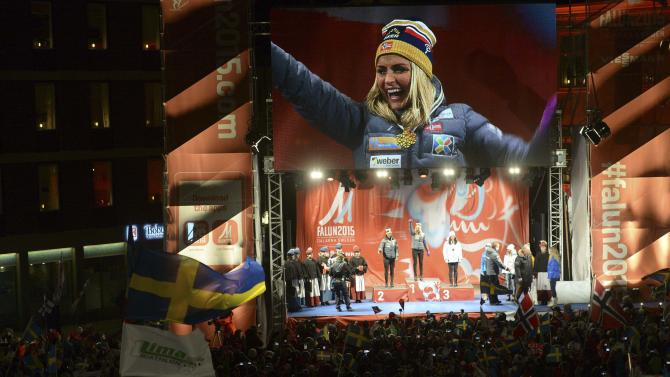 Medallists celebrate on the podium after the women's 30km mass start event at the FIS Nordic Skiing World Championships in Falun