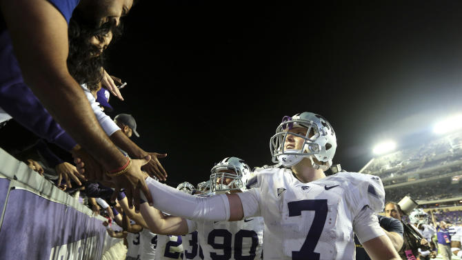 Kansas State quarterback Collin Klein (7) and teammates celebrates with fans in the stands after the NCAA college football game against TCU, Saturday, Nov. 10, 2012, in Fort Worth, Texas. Klein ran for two touchdowns and No. 3 Kansas State bolstered its national title hopes with a 23-10 victory at Big 12 newcomer TCU. (AP Photo/LM Otero)