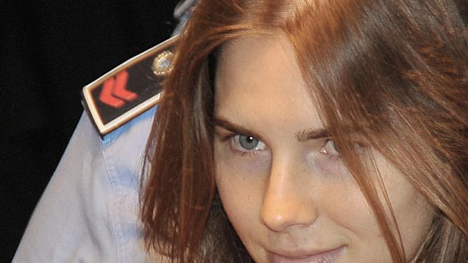 In this Sept. 23, 2011 file photo, Amanda Knox arrives at the courthouse for the appeal trial in Perugia, Italy. On Tuesday, June 18, 2013, Italy's high court has explained why it reversed the acquittal of American student Amanda Knox, saying the decision acquitting her of murder was full of contradictions. In March, 2013, the Court of Cassation overturned Knox's acquittal in the 2007 murder of flatmate Meredith Kercher and ordered a new trial. (AP Photo/Stefano Medici)