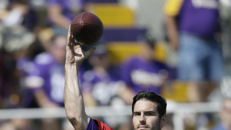 Minnesota Vikings quarterback Christian Ponder throws a pass during NFL football training camp, Friday, July 25, 2014, in Mankato, Minn. (AP Photo/Charlie Neibergall)