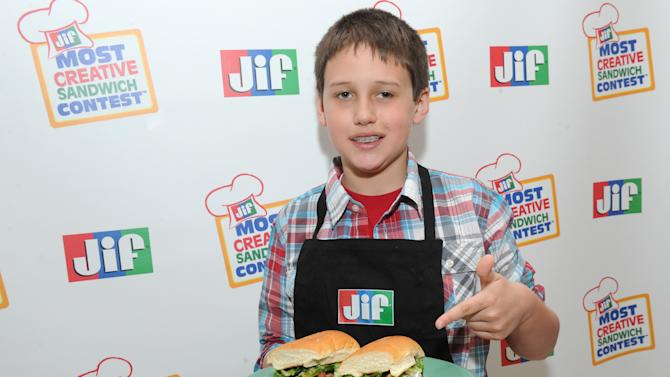 IMAGE DISTRIBUTED FOR THE J.M. SMUCKER COMPANY - Jacob C., age 9 from Morganton, N.C., was named the Grand Prize Winner of the 11th Annual Jif Most Creative Sandwich Contest on Thursday, March 21, 2013 at an event in New York City. He was presented with a $25,000 college fund for his winning recipe, the Magnificent Mole Chicken Torta.(Photo by Diane Bondareff/Invision for The J.M. Smucker Company/AP Images)