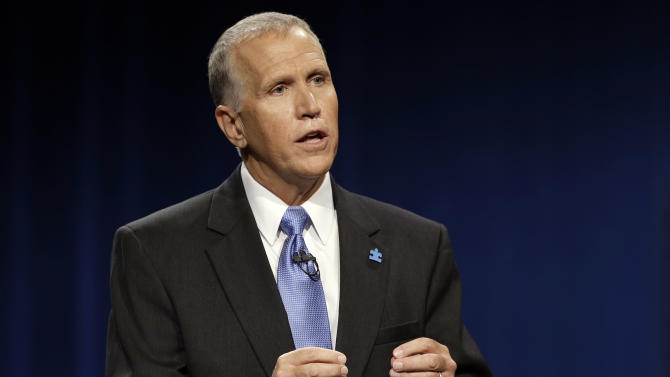 Republican candidate for Senate Thom Tillis makes a statement during a live televised debate with Sen. Kay Hagan, D-N.C., at UNC-TV studios in Research Triangle Park, N.C., Wednesday, Sept. 3, 2014. (AP Photo/Gerry Broome, Pool)