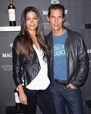 Matthew McConaughey and Camila Alves attend the debut of the 4th edition of the Macallan Masters of Photography Series by Elliott Erwitt at the Leica Gallery Los Angeles on October 24, 2013 in Los Angeles -- Getty Images