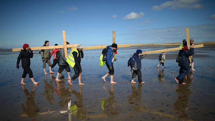 Pilgrims From Across The UK Carry Crosses To Holy Island