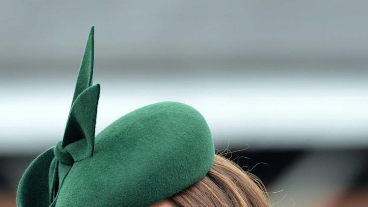 Britain's Catherine, Duchess of Cambridge wears a green hat during a visit with her husband Prince William to the 1st Battalion Irish Guards for a St Patrick's Day Parade at Mons Barracks in Aldershot