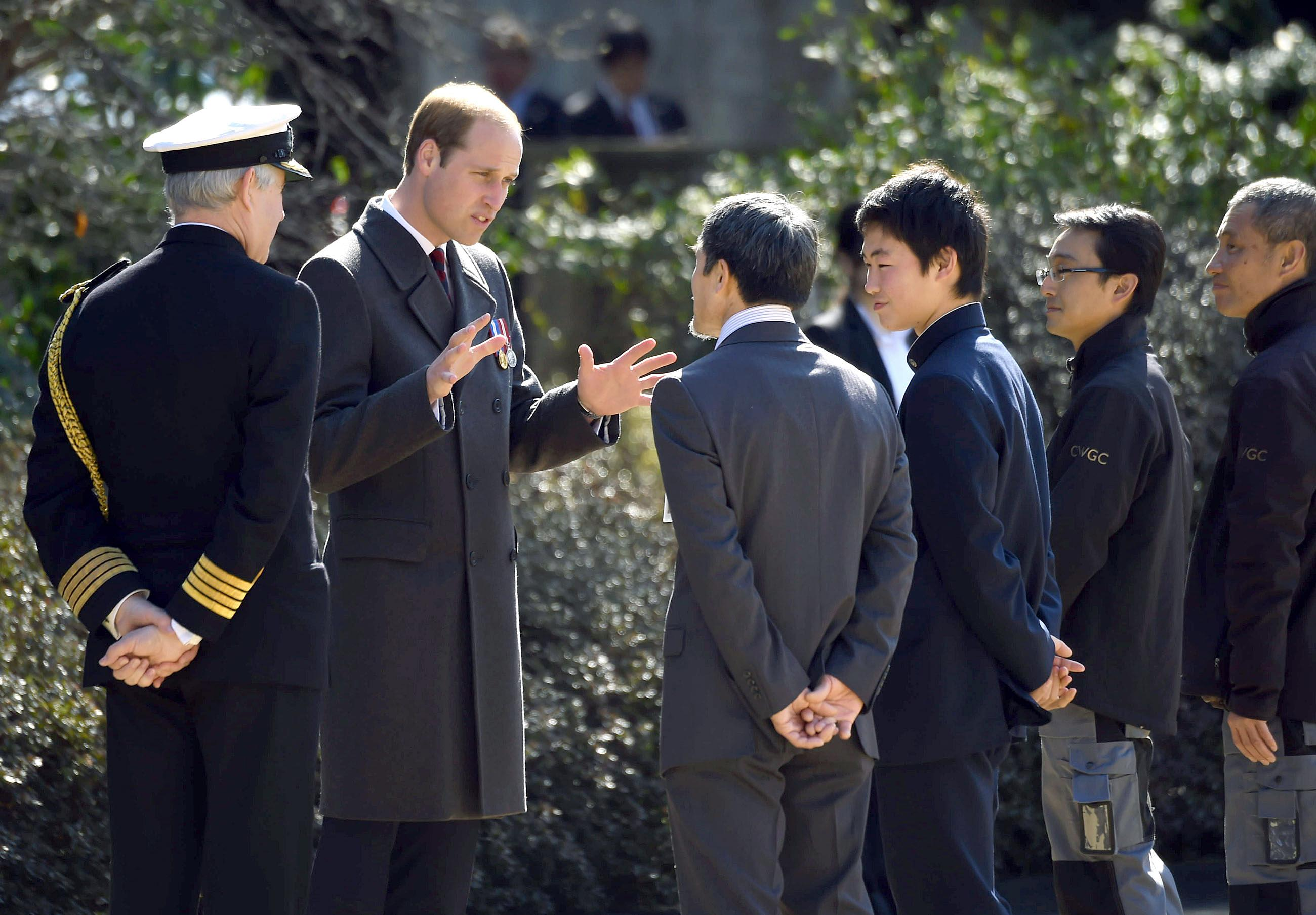 Prince William strikes a friendly contrast to Japan's prince