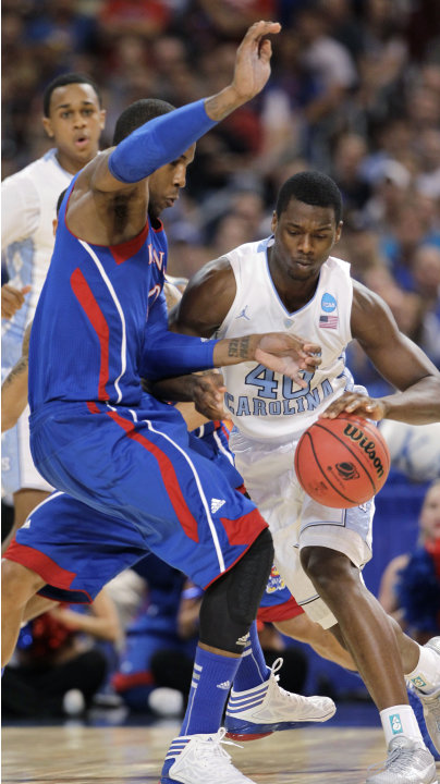 North Carolina forward Harrison Barnes (40) drives against Kansas forward Thomas Robinson during the first half of the NCAA men's college basketball tournament Midwest Regional final Sunday, March 25,