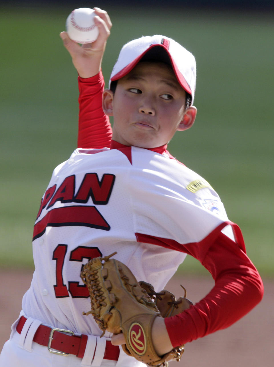 Hamamatsu City, Japan pitcher Shoto Totsuka delivers in the first inning of a baseball game against Langley, British Columbia during a baseball game at the Little League World Series in South Williamsport, Pa.,Tuesday, Aug. 23, 2011.(AP Photo/Gene J. Puskar)
