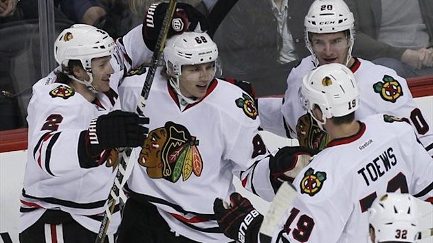 Chicago Blackhawks' Patrick Kane (2nd L) celebrates with team-mates after scoring a second period goal against the Colorado Avalanche (Reuters)