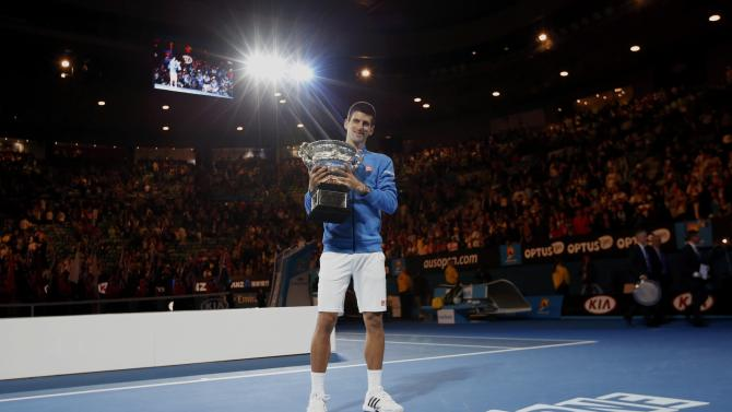 Djokovic of Serbia poses with his trophy after defeating Murray of Britain in their men's singles final match at the Australian Open 2015 tennis tournament in Melbourne