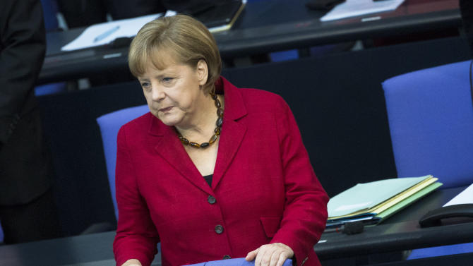 German Chancellor Angela Merkel arrives at the German parliament Bundestag in Berlin, Germany, Thursday, May 24, 2012. (AP Photo/Markus Schreiber)