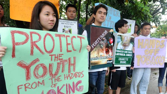 Various civic organizers campaign for a law for graphic health warnings on tobacco products in Manila on June 10, 2014
