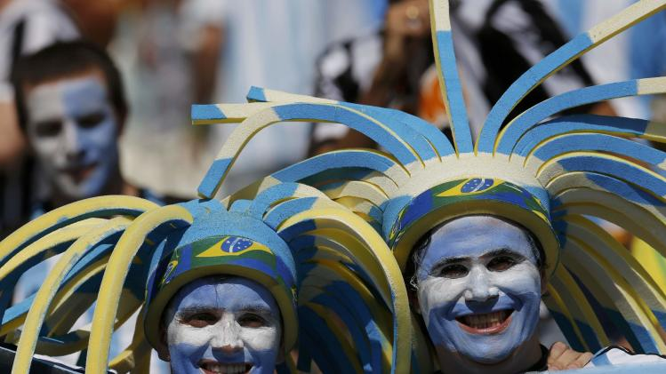 Fans of Argentina pose before their 2014 World Cup Group F soccer match against Iran at the Mineirao stadium in Belo Horizonte
