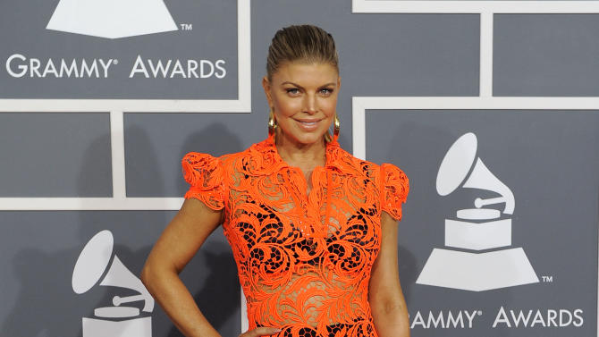 "FILE - This Feb. 12, 2012 file photo shows Fergie at the 54th annual Grammy Awards in Los Angeles. CBS has issued a memo to Grammy Awards attendees against baring too much skin at the ceremony Sunday. The network requests that ""buttocks and female breasts are adequately covered"" for the televised award show. The memo sent out Wednesday, Feb. 6, 2013, also warned against ""see-through clothing,"" exposure of ""the genital region"" and said that ""thong type costumes are problematic."" (AP Photo/Chris Pizzello, file)"