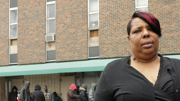 In this March 19, 2013 photo, LaTonya Jenkins stands outside the homeless shelter where she lives in Kansas City, Mo. Missouri's refusal to expand Medicaid under the Affordable Care Act has Jenkins and others concerned that they will lose healthcare benefits. (AP Photo/Charlie Riedel)