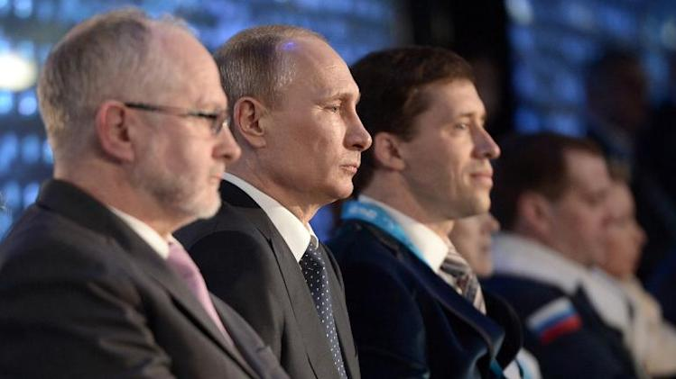 Russian President Vladimir Putin (2nd L) and International Paralympic Committee President Sir Philip Craven (L) attend the opening ceremony of the Sochi 2014 Winter Paralympics in Sochi on March 7, 2014