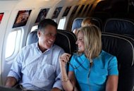 "Republican presidential candidate Mitt Romney (L) and his wife Ann Romney talk on the campaign plane on September 1. President Barack Obama accused Republican foe Mitt Romney on Sunday of failing to offer ""a single new idea"" and being a relic of the last century as he revved up a pre-convention tour"