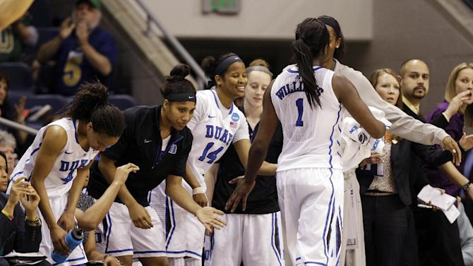 Duke center Elizabeth Williams (1) is welcomed back to the bench during the second half of a regional semifinal in the women's NCAA college basketball tournament against Nebraska, Sunday, March 31 , 2013, in Norfolk, Va. Duke won 53-45. (AP Photo/Steve Helber)