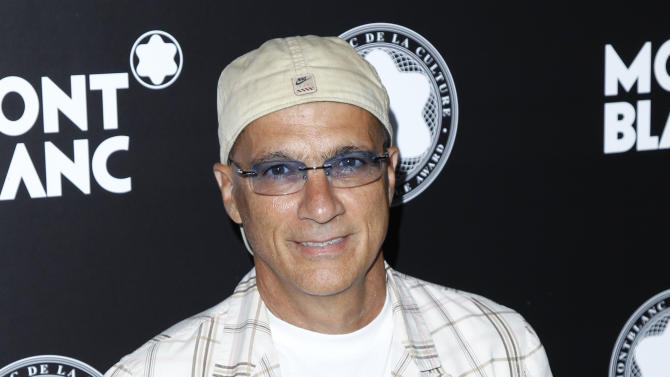 """FILE - This Oct. 2, 2012 file photo shows chairman of Interscope-Geffen A&M Jimmy Iovine attends Montblanc de la Culture Arts Patronage Award honoring Quincy Jones in Los Angeles. Iovine and Luke Wood were so moved by the """"Muscle Shoals"""" documentary, they're putting up money to make sure the unique spirit of the Alabama music haven lives on. The Beats Electronics officials are starting a program to refurbish and upgrade two historic studios in Muscle Shoals _ FAME Recording Studios and Muscle Shoals Sound Studio _ then will install education programs to train a new generation of producers, audio engineers and musicians. (Photo by Joe Kohen/Invision/AP, File)"""