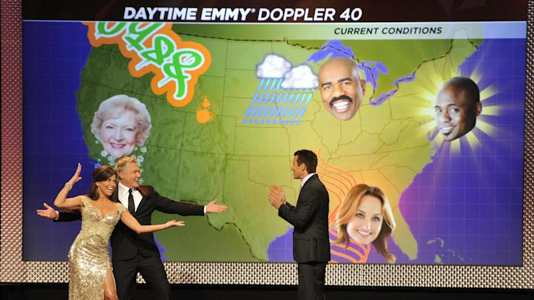 Hosts, from left, Robin Meade, Sam Champion and A. J. Hammer perform on stage at the 40th Annual Daytime Emmy Awards on Sunday, June 16, 2013, in Beverly Hills, Calif. (Photo by Chris Pizzello/Invision/AP)
