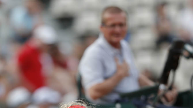 Denmark's Caroline Wozniacki argues with chair umpire Poncho Ayala, of Spain, behind, as she plays Estonia's Kaia Kanepi during their third round match in the French Open tennis tournament at the Roland Garros stadium in Paris, Saturday, June 2, 2012.  (AP Photo/Bernat Armangue)