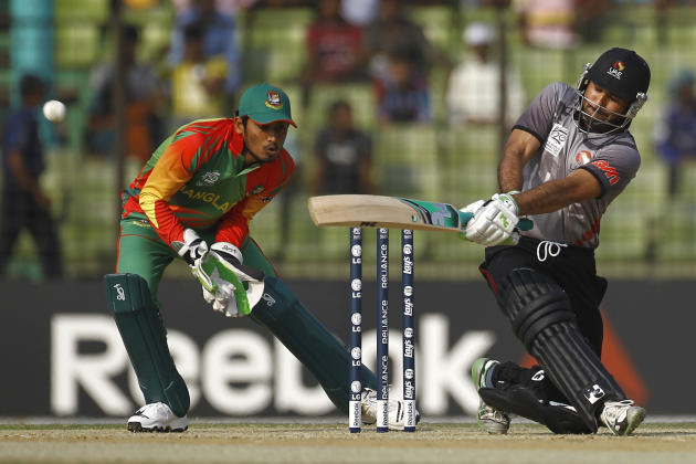 United Arab Emirate's Amjad Ali, right, bats, as Bangladesh's wicketkeeper Anamul Haque watches during a warm-up cricket match ahead of the Twenty20 World Cup Cricket in Fatullah, near Dhaka, Banglade