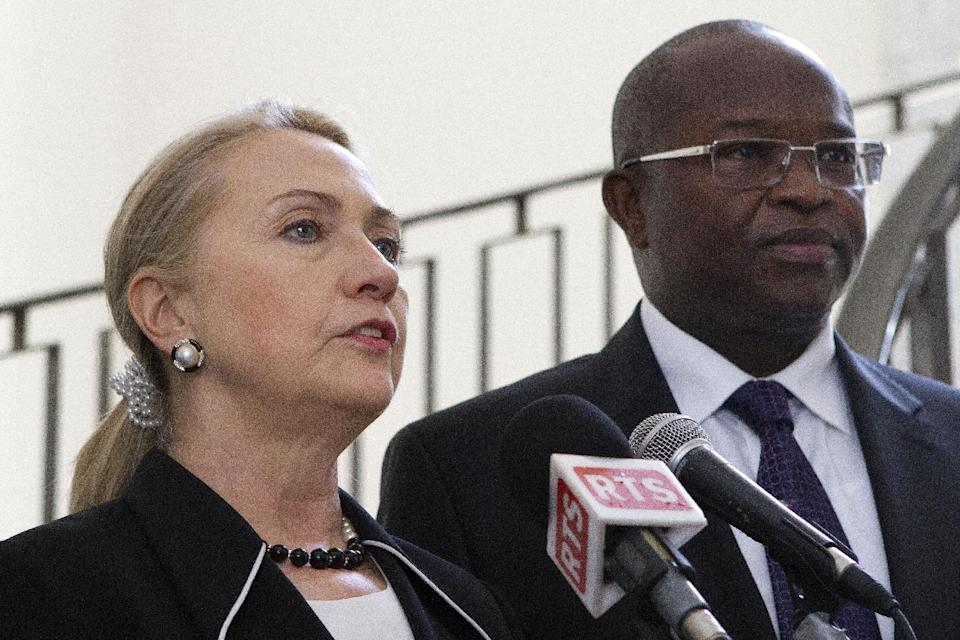 Secretary of State Hillary Rodham Clinton, accompanied by Senegal's Foreign Minister Alioune Badara Cisse, speaks at the Presidential Palace in Dakar, Senegal, Wednesday, Aug. 1, 2012. (AP Photo/Jacquelyn Martin, Pool)