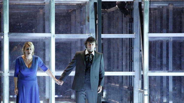In this photo dated Dec. 16, 2010 photo, soprano Anja Kampe as Leonore, left, and tenor Jonas Kaufmann as Florestan are seen during a dress rehearsal for Ludwig van Beethoven's opera 'Fidelio' in the state opera in Munich, southern Germany. (AP Photo/dapd, Sebastian Widmann)