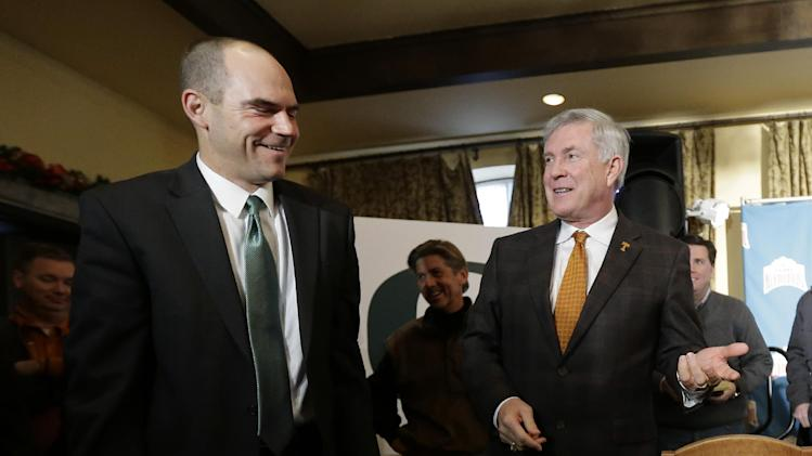 Oregon coach Mark Helfrich, left, and Texas coach Mack Brown, right, visit following a Valero Alamo Bowl news conference, Thursday,  Dec. 12, 2013, in San Antonio. Texas and Oregon will play in the NCAA college football game Dec. 30