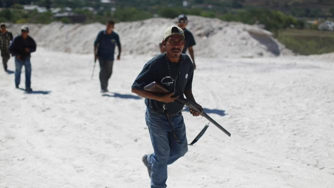 Members of the Community Police of the FUSDEG patrol the village of Petaquillas, on the outskirts of Chilpancingo