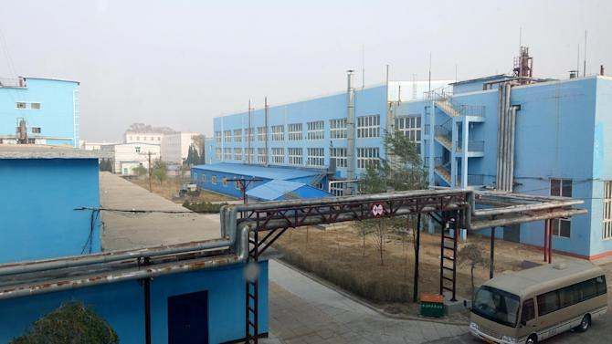 In this photo taken Oct. 24, 2014, the Tianhe Fuxin flourochemical plant in Jinzhou, China. Two Morgan Stanley-backed Chinese companies will not be filing their financial statements on time and have stopped trading in their stocks, raising concerns about their accounting and the U.S. banking giant's stewardship of $1.4 billion entrusted to its Asian investing arm. (AP Photo/Erika Kinetz)