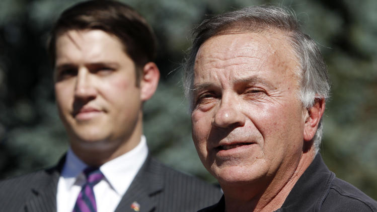 In this Oct. 2, 2012 photo, former Republican U.S. Rep. Tom Tancredo speaks out in favor supporting Amendment 64 to legalize marijuana in Colorado during a news conference at the Capitol in Denver. Joe Megyesy coordinator for the campaign to regulate marijuana like alcohol listens at left. Appealing to Western individualism and a mistrust of federal government, activists have lined up some prominent conservatives as natural allies to make pot legal, from one-time presidential hopefuls Tom Tancredo and Ron Paul to Libertarian presidential candidate and former New Mexico Gov. Gary Johnson. (AP Photo/Ed Andrieski)