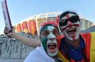 An Italy fan and an England fan party outside the Olympic Stadium in Kiev before tonight's Euro 2012 quarter-final