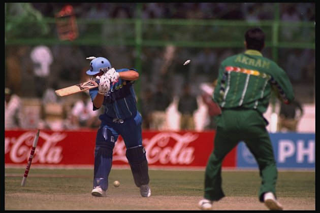DARREN GOUGH IS BOWLED BY AKRAM
