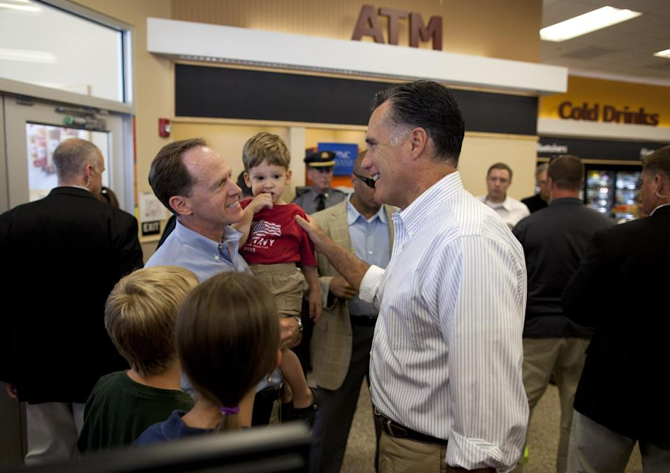 Republican presidential candidate, former Massachusetts Gov. Mitt Romney, right, talks with Sen. Patrick Toomey, R- Pa., during a stop at Wawa gas station in  in Quakertown, Pa., Saturday, June 16, 2012.  (AP Photo/Evan Vucci)