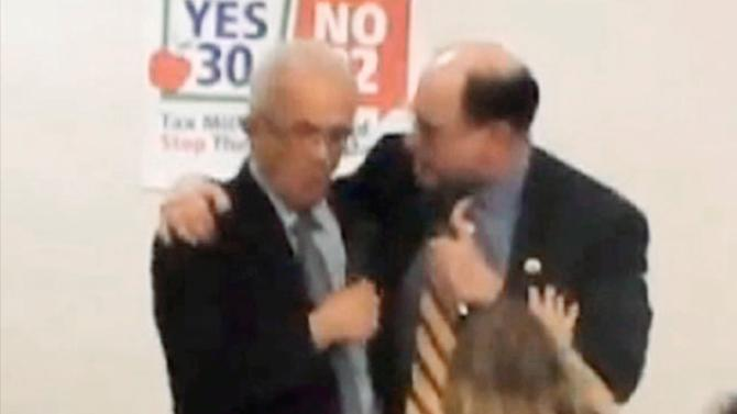 "This image from Thursday evening, Oct. 11, 2012 video provided by a Howard Berman campaign videographer shows Brad Sherman, right, putting his right arm around Howard Berman during a debate at Pierce College in Los Angeles. Sherman seized the shoulder of Berman, brought him toward his chest and shouted, ""You want to get into this?"" The physical confrontation between the two veteran Democratic House members vying for the same Los Angeles-area congressional seat is the latest example of a campaign that has become increasingly bitter and personal. (AP Photo/Brandon Hall)"