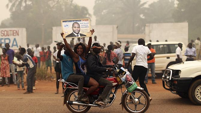 Supporters of presidential candidate Faustin-Archange Touadera celebrate during a campaign ahead of Sunday's second round election against Anicet-Georges Dologuele in Bangui, Central African Republic