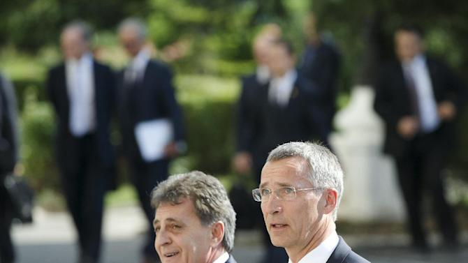 NATO Secretary General Jens Stoltenberg, right, walks with Romanian defense minister Mircea Dusa, left, during a welcoming ceremony in Bucharest, Romania, Thursday, July 2, 2015. Stoltenberg is meeting top officials in Romania and will inspect a site where the alliance will build a facility dubbed the NATO Force Integration Unit that is similar to ones planned in Poland, Bulgaria and the three Baltic states — Estonia, Latvia and Lithuania, in reaction to the crisis in Ukraine.(AP Photo/Vadim Ghirda)