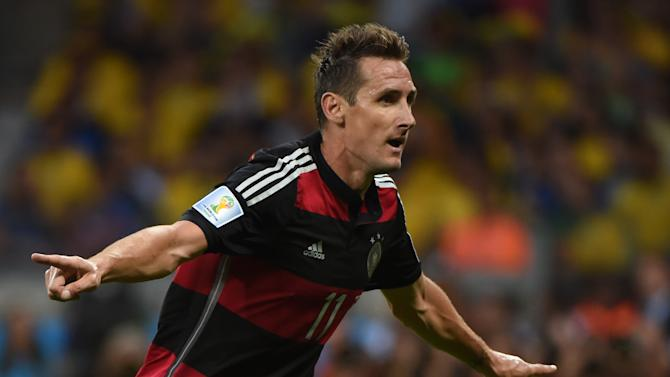 Germany's forward Miroslav Klose reacts after scoring during the semi-final football match between Brazil and Germany at The Mineirao Stadium in Belo Horizonte on July 8, 2014, during the 2014 FIFA World Cup