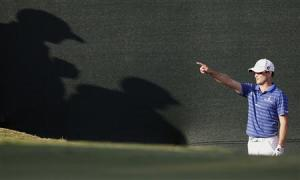 Zach Johnson of U.S. points towards where he is intending to hit his ball during the Tour Championship in Atlanta