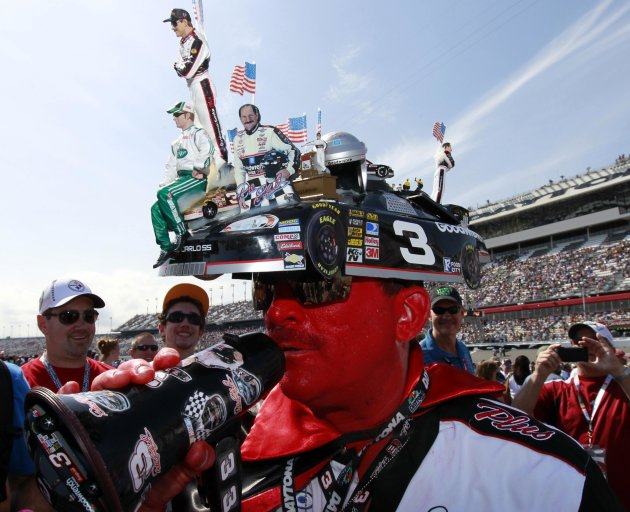"A race fan who identified himself as ""Tony NASCAR"" walks on the pit road before the start of the first NASCAR Sprint Cup Series Budweiser Duel at the Daytona International Speedway in Daytona Beach"
