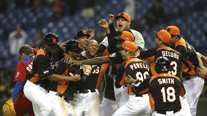 Netherlands' players celebrate just after their walk-off win over Cuba in their World Baseball Classic second round game at Tokyo Dome in Tokyo, Monday, March 11, 2013. Netherlands won 7-6 to advance to finals. (AP Photo/Toru Takahashi)