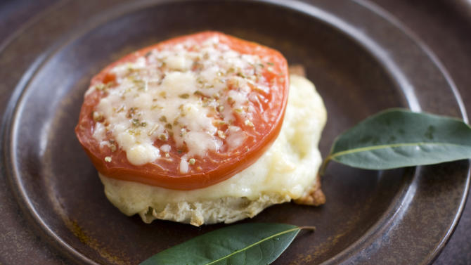 In this image taken on April 1, 2013, an English muffin broiled cheese and tomato sandwich is shown in Concord, N.H. (AP Photo/Matthew Mead)